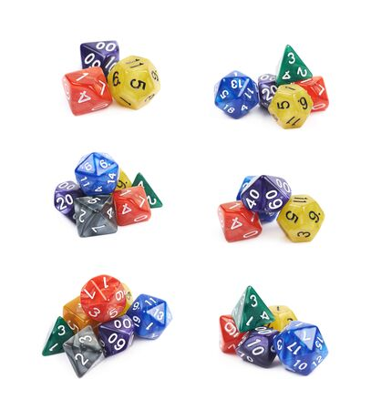 Pile of colorful roleplaying polyhedral dices isolated over the white background, set of six different foreshortenings Stock Photo