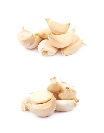 Pile of garlic cloves isolated Stock Photo