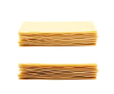 Pile of dried lasagna sheets isolated