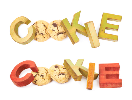 Word Cookie made of cookies and colored with paint wooden letters, composition isolated over the white background, set of two different foreshortenings