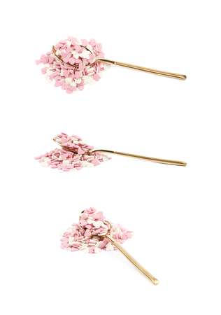 heart shaped: Spoon full of sugar heart shaped sprinkles isolated over the white background, set of three different foreshortenings