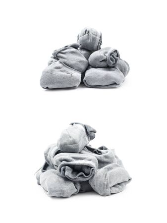 Pile of a gray low-cut ped socks isolated over the white background, set of two different foreshortenings