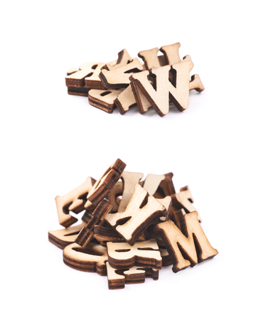Pile of wood carved letters isolated over the white background, set of two different foreshortenings