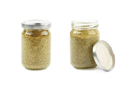Glass jar of the green italian pesto isolated over the white background, set of two different foreshortenings Banco de Imagens