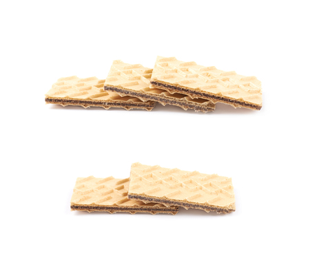 Pile of chocolate wafers isolated over the white background, set of two different foreshortenings Stock Photo