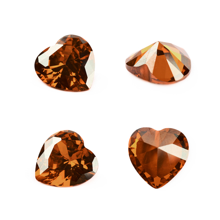 heart shaped: Heart shaped orange gem stone isolated over the white background, set of four different foreshortenings Stock Photo
