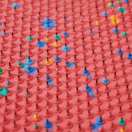 Close-up crop fragment of an orthopedic mat with spikes