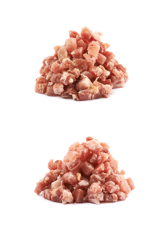 Pile of raw bacon cube bits isolated over the white background, set of two different foreshortenings