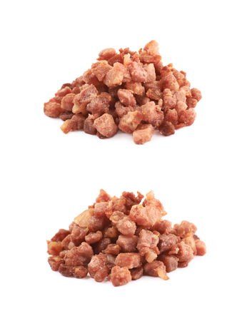 pancetta cubetti: Pile of fried bacon cube bits isolated over the white background, set of two different foreshortenings