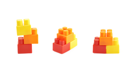 Pile of multiple plastic construction toy bricks isolated over the white background, set of three different foreshortenings