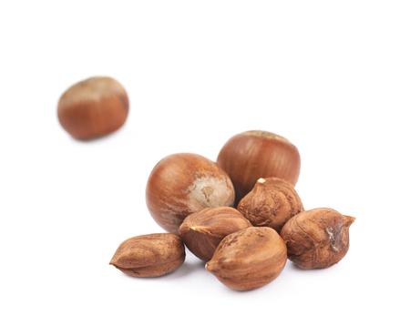 Pile of hazelnuts isolated over the white background