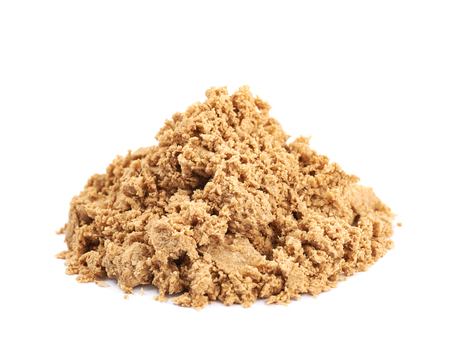 sunflower seeds: Pile of crushed and crumbled turkish halva confection, composition isolated over the white background Stock Photo