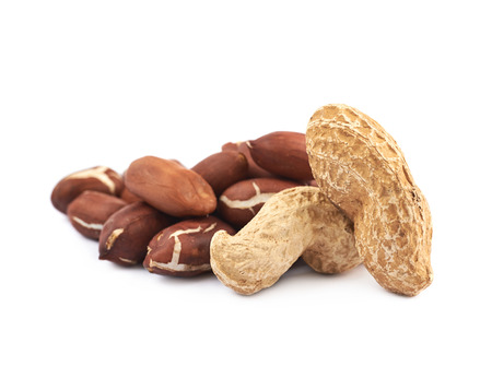 nutshells: Pile of peanuts isolated over the white background Stock Photo