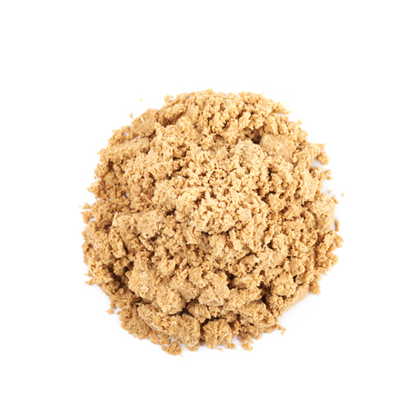 Pile of crushed and crumbled turkish halva confection, composition isolated over the white background Stock Photo