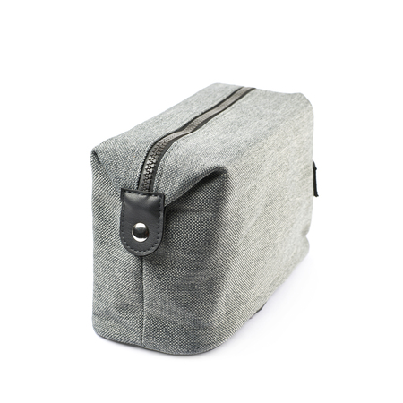 vanity bag: Gray hygienic handbag with the zip fastener isolated over the white background