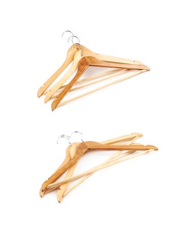 clotheshanger: Pile of light wooden hangers Stock Photo