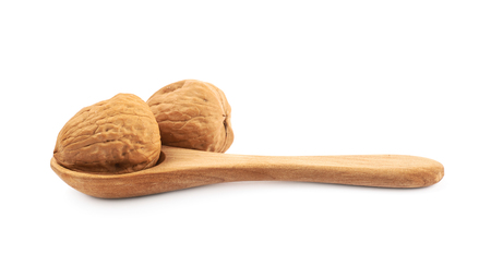 Walnut in a wooden spoon isolated
