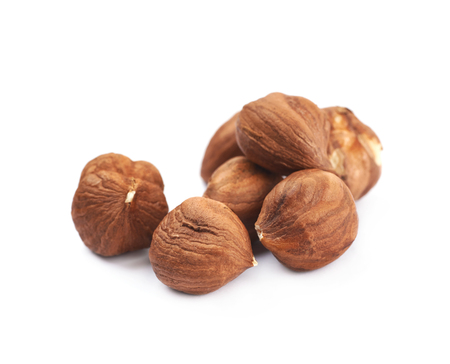 Pile of hazelnuts isolated over the white background