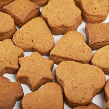 Suface coated with the multiple differently shaped hand-made cookies as a backdrop composition Stock Photo