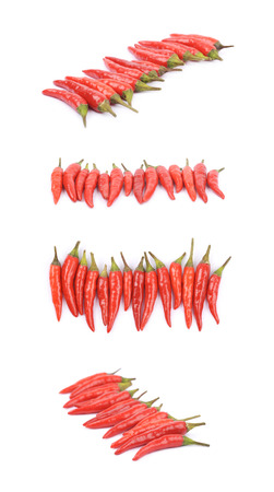 hottest: Lined up pile of red italian peppers isolated over the white background, set of four different foreshortenings