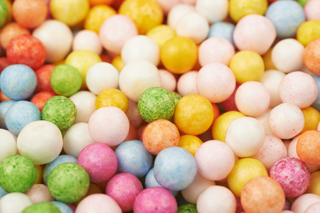 composition: Surface coated with colorful balls or sphere shaped breakfast cereals as an abstract backdrop composition Stock Photo