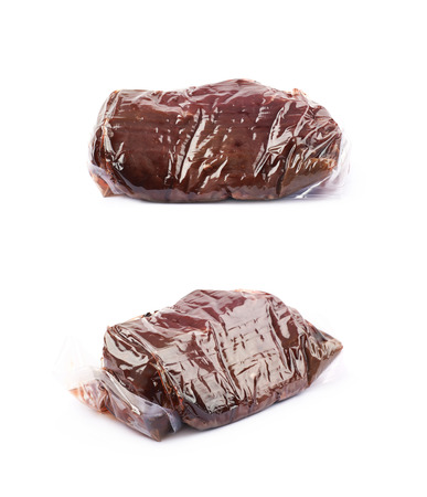 Vacuum packed slice of a beef meat isolated over the white background, set of two different foreshortening