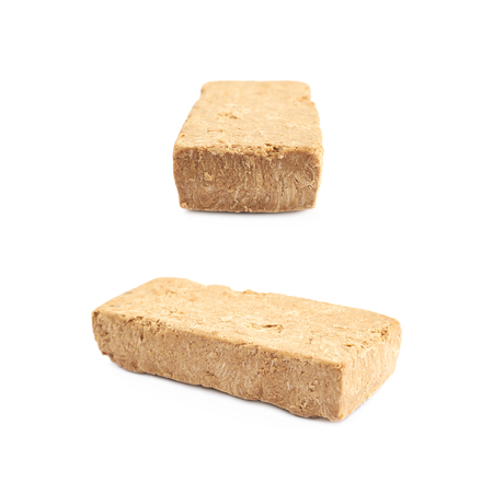 Briquette of nut halva confection isolated