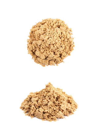Pile of crushed and crumbled turkish halva confection, composition isolated over the white background, set of two different foreshortenings