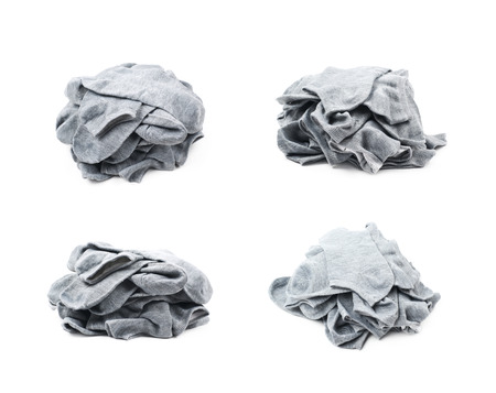 Pile of a gray low-cut ped socks isolated over the white background, set of four different foreshortenings