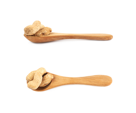 nutshells: Spoon full of peanuts isolated over the white background, set of two different foreshortenings
