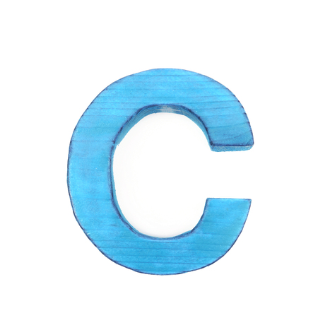 Single sawn wooden letter C symbol coated with paint isolated over the white background
