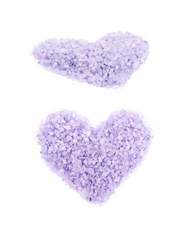 Heart shape made of salt crystals isolated over the white background, set of two different foreshortenings Stock Photo