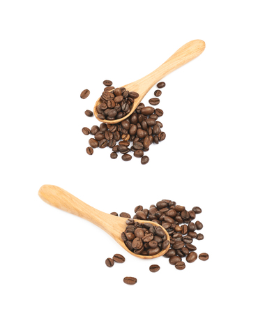 Pile of brown roasted coffee beans with the wooden spoon over it, composition isolated over the white background, set of two different foreshortenings Stock Photo