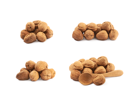 Pile of walnuts isolated over the white background, set of four different foreshortenings