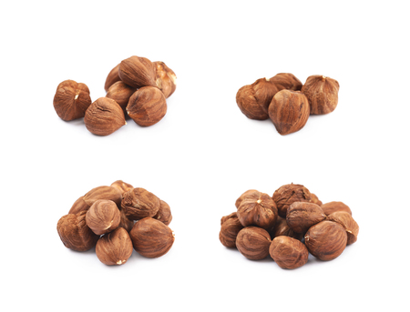 Pile of hazelnuts isolated over the white background, set of four different foreshortenings