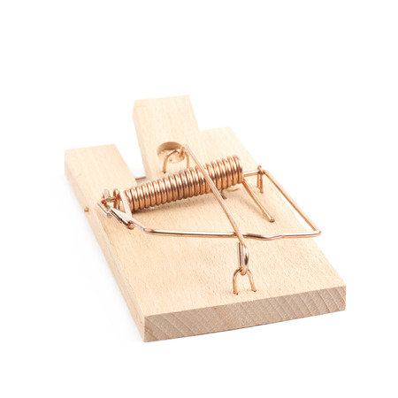 Wooden mousetrap device isolated over the white background