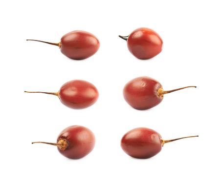 Ripe tamarillo fruit isolated over the white background