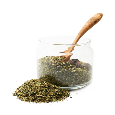 Mate tea leaves in a glass jar isolated over the white background