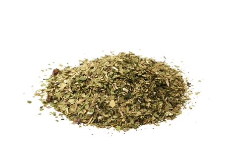 Pile of mate tea leaves isolated over the white background Imagens