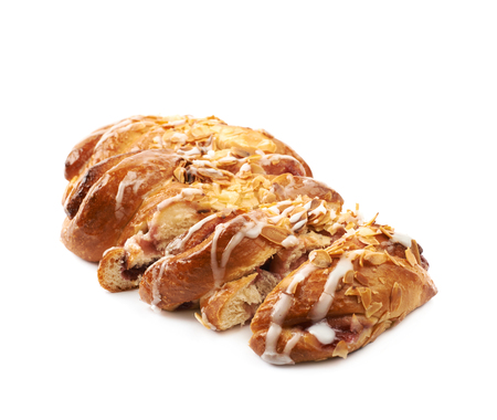 Sweet cinnamon pastry bun isolated over the white background