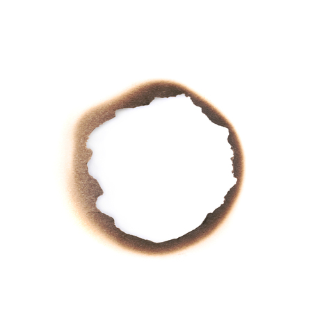 Round paper burn mark stained hole isolated over the white background