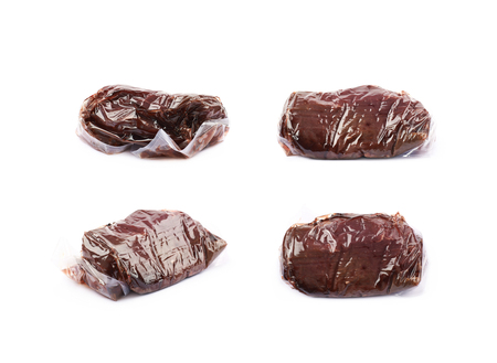 Vacuum packed slice of a beef meat isolated over the white background, set of four different foreshortenings Stock Photo
