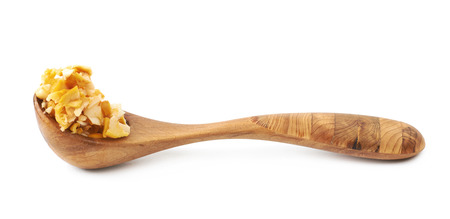 Yellow chanterelle mushroom and wooden serving spoon, composition isolated over the white background Stock Photo