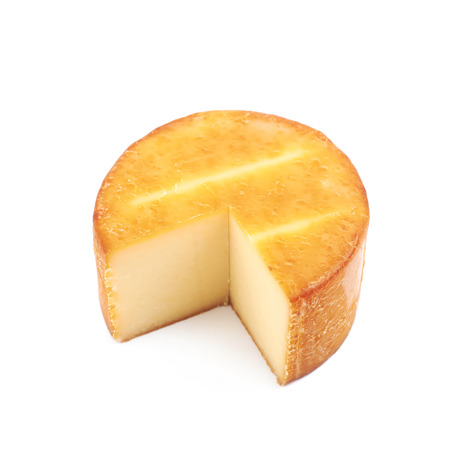 Sliced wheel of cheese isolated over the white background