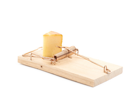 Wooden mousetrap with a piece of cheese inside, composition isolated over the white background