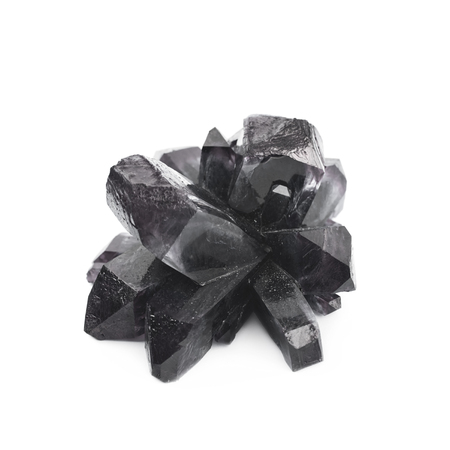 Grown crystal of black colored salt isolated over the white background Stock Photo