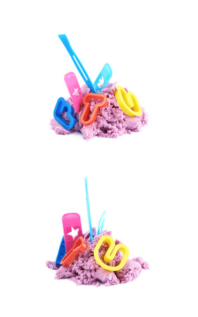 Pile of kinetic sand with the plastic letter molds over it, composition isolated over the white background, set of two different foreshortenings