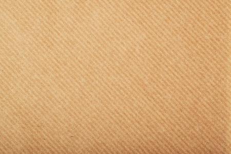 Close-up fragment of a brown stripped wrapping paper
