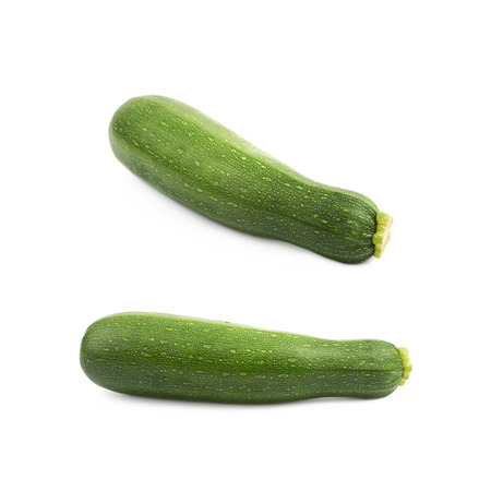 Green zucchini plant isolated over the white background , set of several different foreshortenings