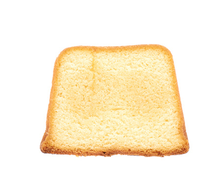 Measured portion of exactly hundred calories of a moist butter cake isolated over the white background